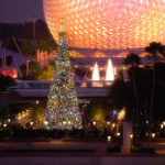"""EPCOT LIGHTS UP THE HOLIDAY NIGHTS:  The giant Christmas tree at Epcot, seen with the park's iconic Spaceship Earth attraction behind it, is the centerpiece of the holiday celebration at the theme park in Lake Buena Vista, Fla.  It's all part of the Walt Disney World theme park's annual """"Holidays Around the World"""" celebration, in which international traditions of the season unfold all throughout World Showcase. (Garth Vaughan, photographer)"""